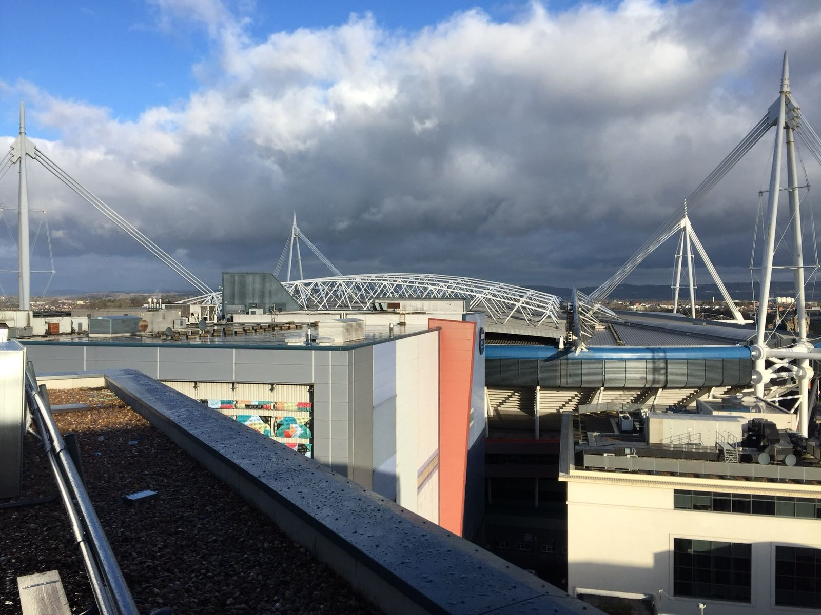 The view of Cardiff stadium from a industrial buildings flat roof
